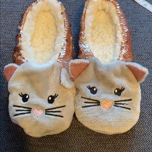 Fuzzy sequined cat slippers.